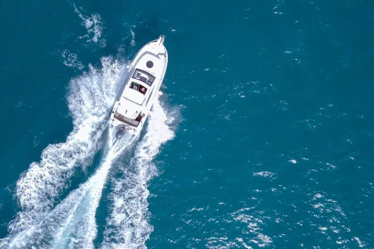 aerial view of boat cruising through the blue waters
