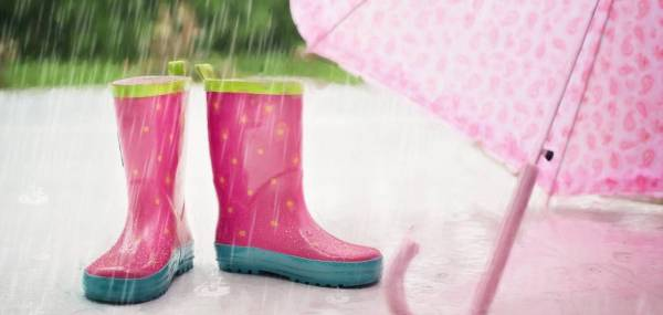pink rain boots and umbrella with rain falling down